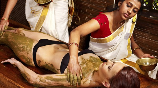 Woman having Ayurvedic body  spa massage.