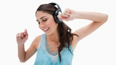 Woman dancing while listening to music