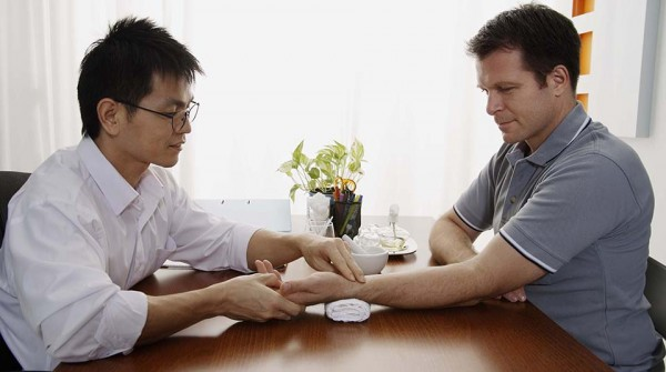 Doctor and patient consultation in osteopathic office